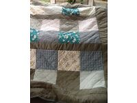Handmade single patchwork quilt in greens