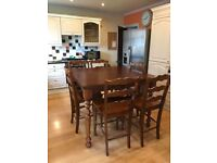 Solid wood dining table and 6 matching chairs