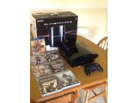PS3 boxed with all leads 1controller and 7 games