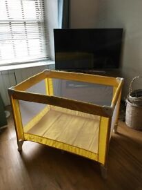 Yellow Baby Weaver Travel Cot.