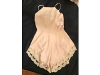 Size 8 playsuit with tags