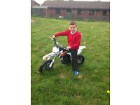 Children's electric motor bike excellent condition l