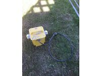 110 volt transformer. Yellow.