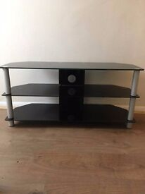Large glass TV stand.