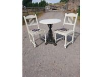 oak bistro table with cast iron base and little red riding hood chairs