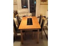 Dining Table with four leather chairs for sale