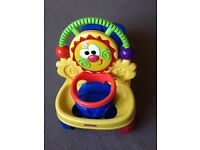 Fisher price musical walker and ride along toy to aid the learning to walk