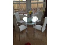 4 faux leather chairs with glass table , changing decor and doesn't suit, only had for 6 months