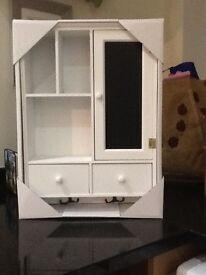 Small white cabinet with blackboard and two hooks