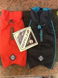 2 Repelz-it waterproof dog coats. Red/blue £20 for the 2.