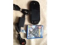 Sony ps vita touch screen excellent working condition with game and charger
