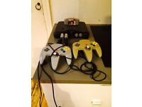 Nintendo 64 with GOLDENEYE and SUPER MARIO 64!! in prime working condition with two controllers!!