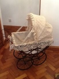 Lovely girls pram in wrought iron and cane