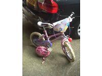 Childs bike and helmet.