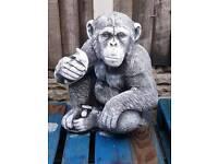 Chimp with banana garden ornament