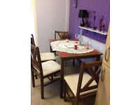 Antique Solid oak Dining table and four chairs