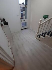 WHITE LAMINATE FLOOR ONLY £7M2