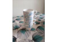 Set of 4 Next mugs. Like new.