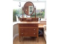 Old fashioned wooden drawers with oval mirror