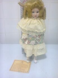 porcelain doll name is Heather approx is 15 inch on stand in a box with certificate