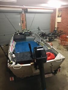 $2,500 Registered boat & trailer good motor