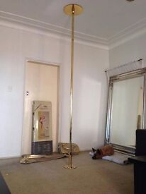 Auralian sports grip pole dancing pole with brand new stylish sport and carry bags.