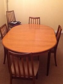 Dining table, six chairs and sideboard.