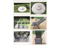 BARGAIN! Weather resistent garden table and 6 chairs.