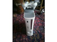 Xbox 360 60 Gb with wireless joystick and some games