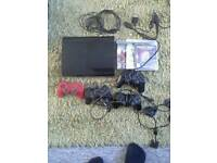 Ps3super slim/ps2 bundle with 6 controllers 60+games
