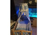 Swinging crib with bedding and drapes