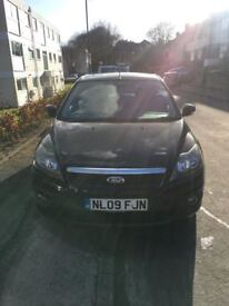 2009 Ford Focus 1.6 with 93k on the clock and 12 months MOT