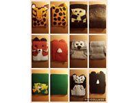 Handmade crocheted iPad/tablet covers.
