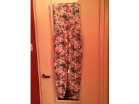 Womans floral jumpsuit size 8