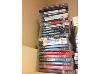 PS3 in box with two controllers and 24 games