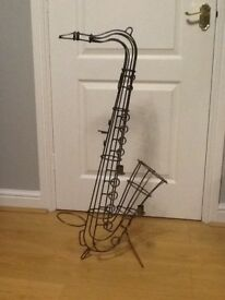 Candle holder, saxophone design