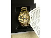 Spirit ladies gold tone/ butterflies watch