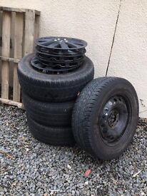 2 x 235 x 65 (Continental Tyres) and 2 x 215 x 65 (1 x Continental) - Trims included