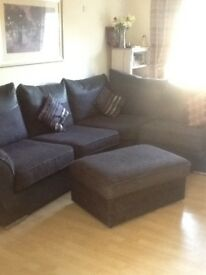 Black and purple corner sofa with pouffe