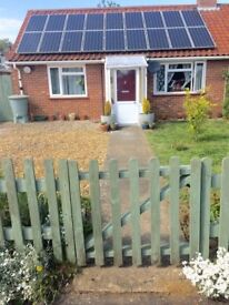 Good size 2 bed bungalow - drive/large gardens with conservatory