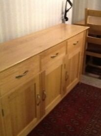 Oak sideboard and matching table and four chairs