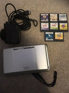Silver Nintendo DS with 8 games, charger & car charger Southbank Melbourne City Preview