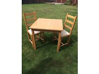 Dining/kitchen table and two chairs
