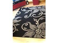 Grey and black floral rug