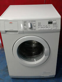 I553 white aeg 8kg 1400spin washing machine comes with warranty can be delivered or collected