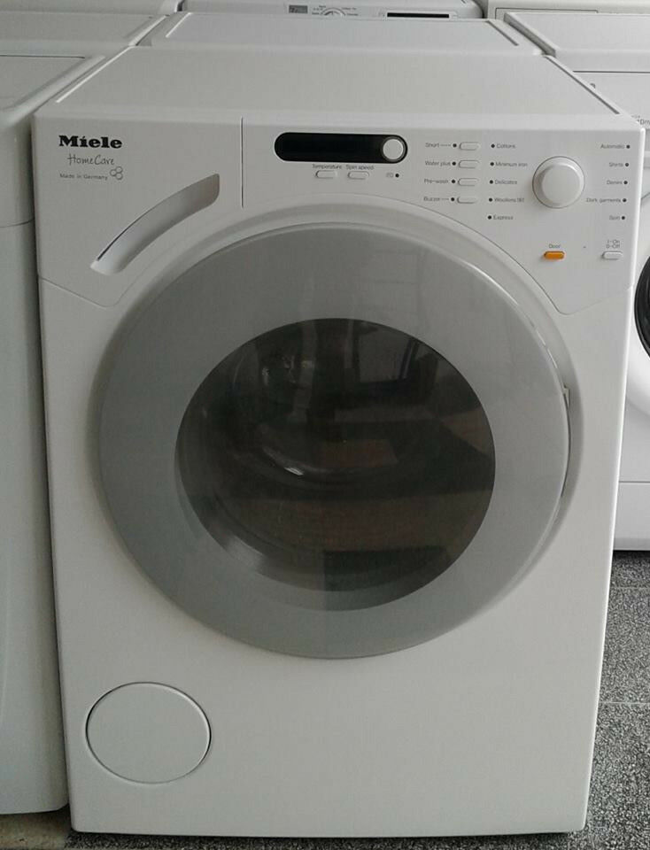 J674 white miele 6kg 1200 spin washing machine comes with warranty can be delivered or collected