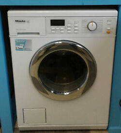 I692 white miele 5kg 1600spin washer dryer comes with warranty can be delivered or collected