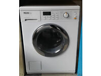 J713 white miele 5kg 1600spin washer dryer comes with warranty can be delivered or collected