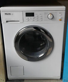 E713 white miele 5kg 1600spin washer dryer comes with warranty can be delivered or collected