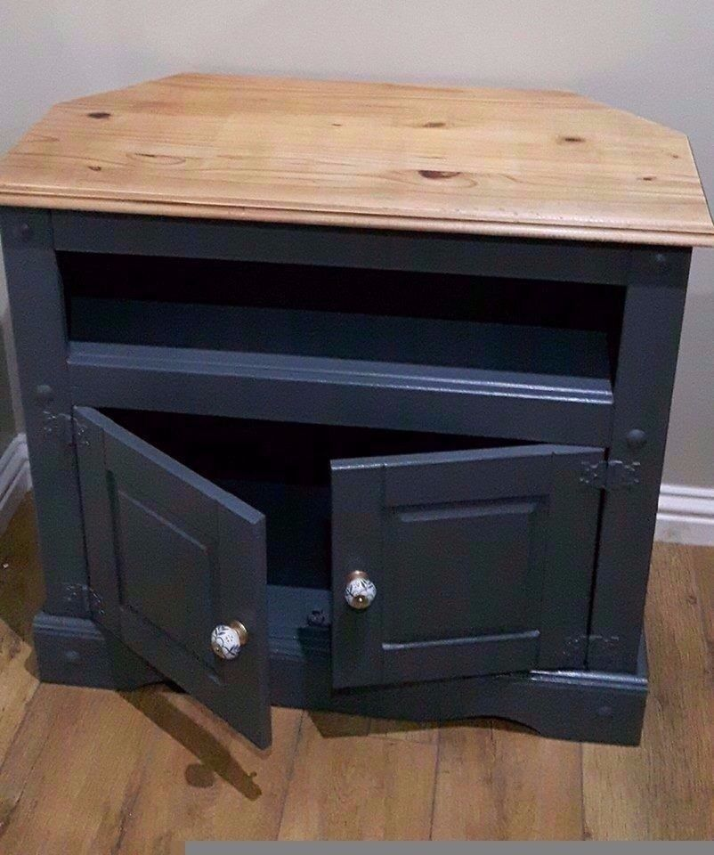solid wood enclosed storage tv unit will fit neatly in corner or flat against a wall ( 50 inch tv)